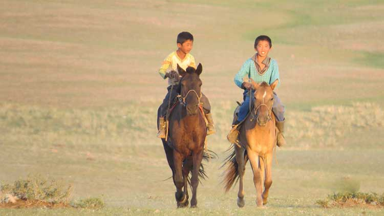 mongolian boys on horses