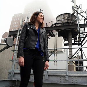 Sarah Hall Standing on top of building